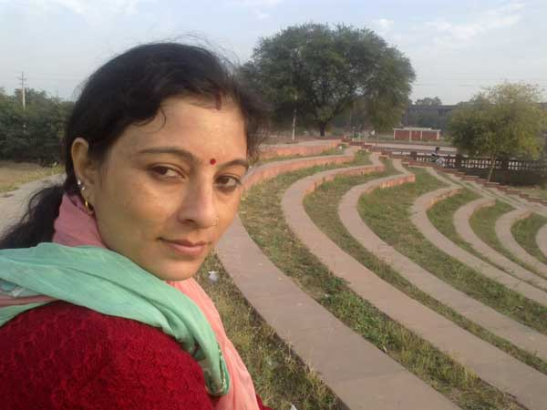 With my wife (Suti) at sector 42, near Beant Singh memorial, sitting on stairs while viewing children playing cricket on the campus